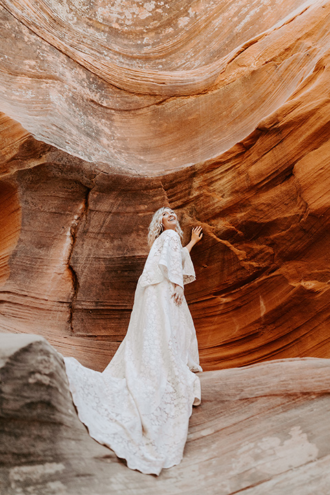 bride in an ivory long gown with bellowing sleeves and a boho design