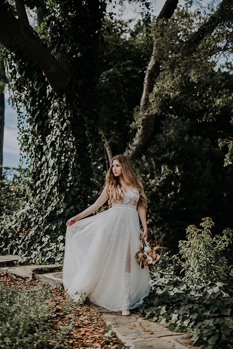 bride in a bohemian lace gown with a tulle skirt, lace boots