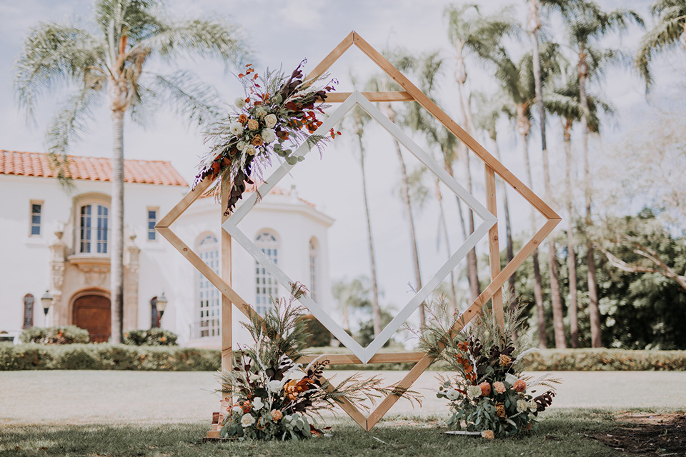 geometric gold arch with bohemian florals