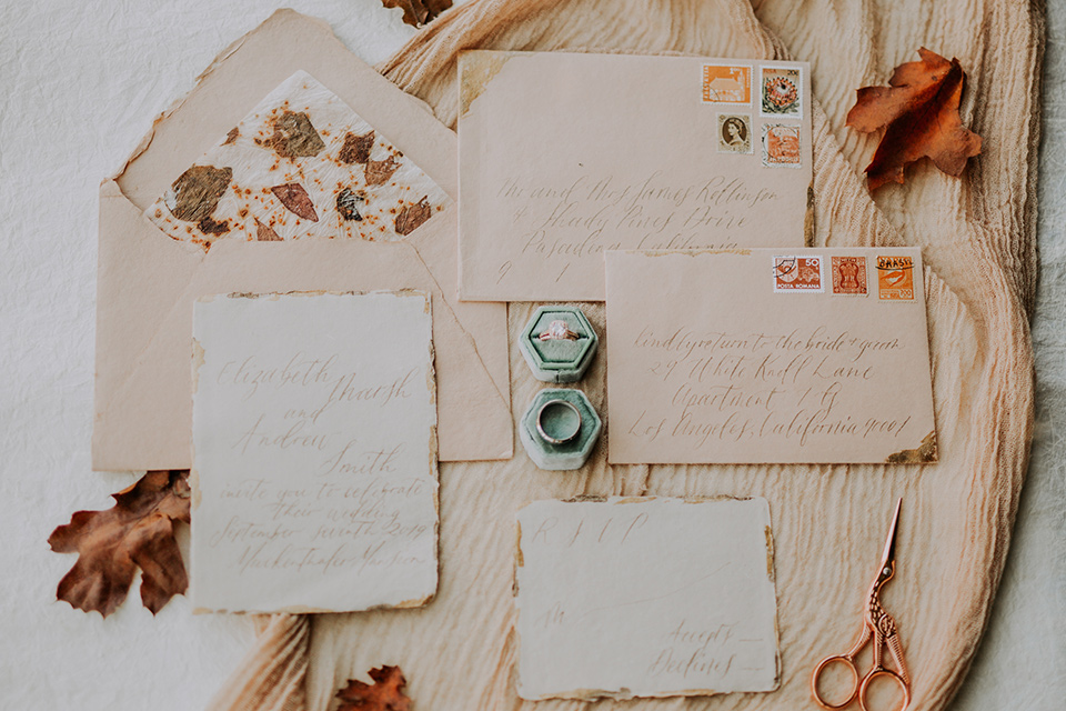 invitations with gold and orange calligraphy