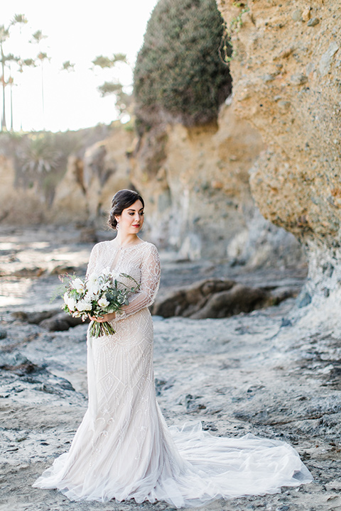 bride in a flowing gown with an illusion neckline and hair in a soft updo with a crystal pin detail