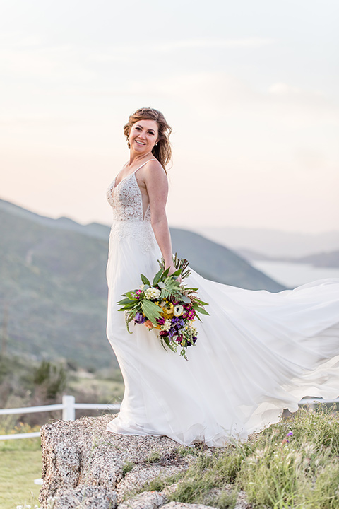 bride in a lace gown with thin straps and beaded bodice