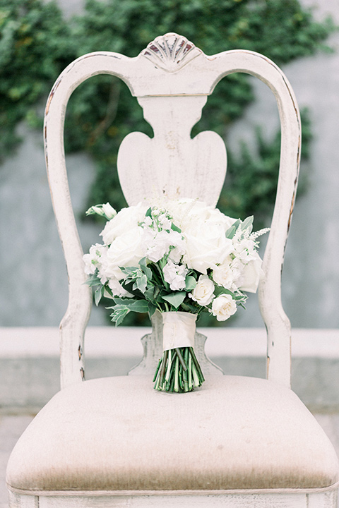 white and green florals on a white chair
