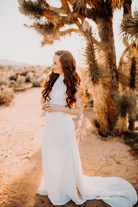 bride in a high neckline gown with lace details