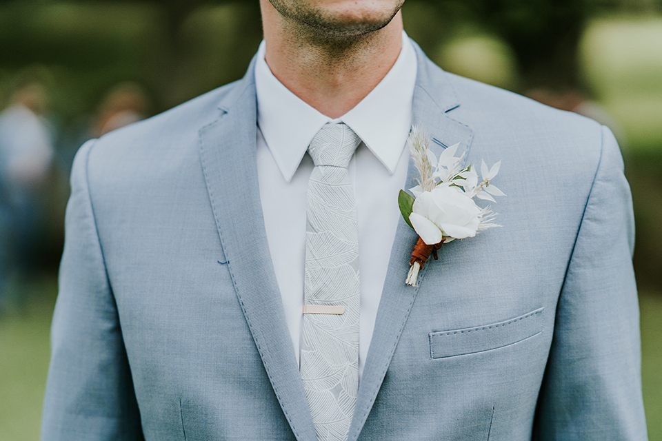 groom in light blue suits with a long tie