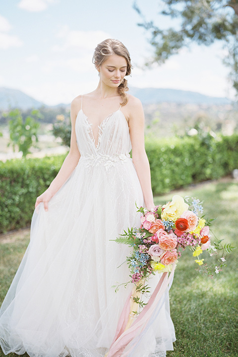 bride in a white flowing gown with a v neckline