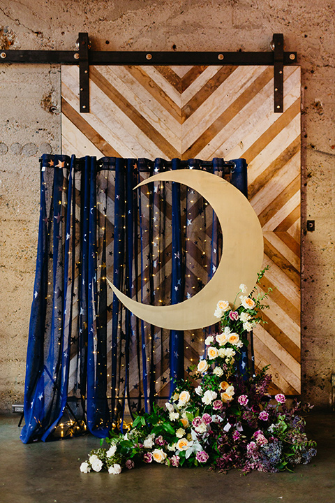 ceremony altar with blue linens and a moon decal