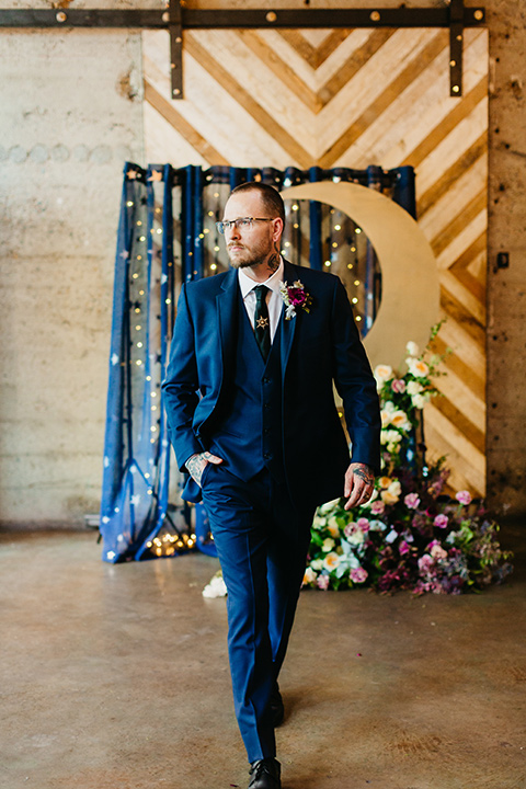 groom in a cobalt blue suit and a black long tie