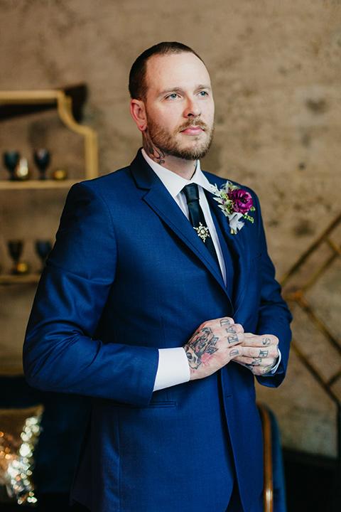 bride in groom in a cobalt blue suit and a black long tie