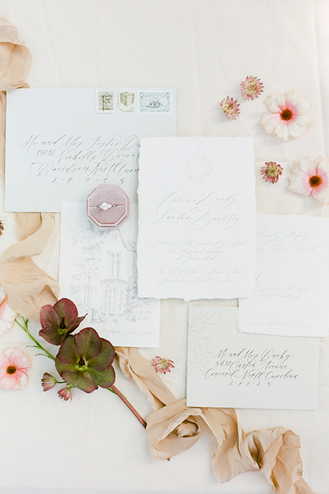 white invitations with gold calligraphy design