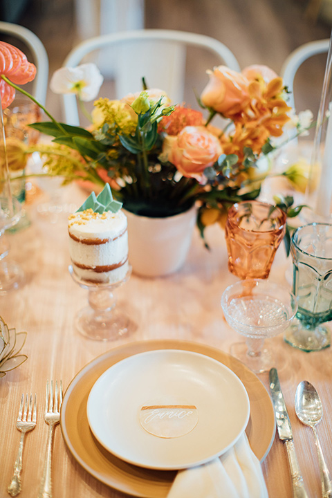 peach and gold table scape décor with blue glass menus