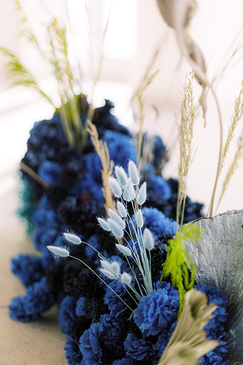 blue orchids used as décor in the reception area