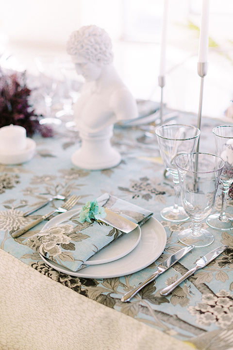 floral linens with matching napkins on reception table