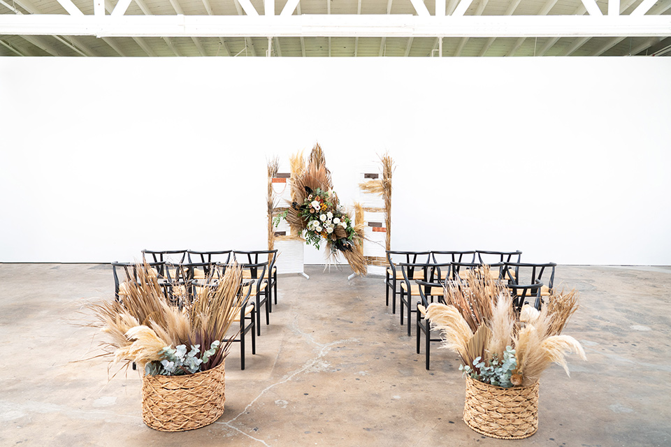 ceremony décor with pampas grass and bohemian decor