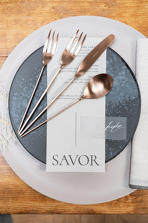 the white plates with gold flatware