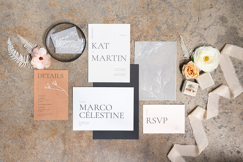 neutral invitations with calligraphy and gold details