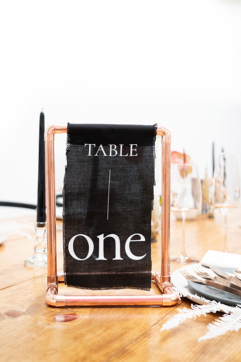black menu cards and table numbers