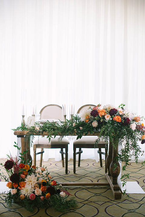 sweetheart table with a rustic décor and florals