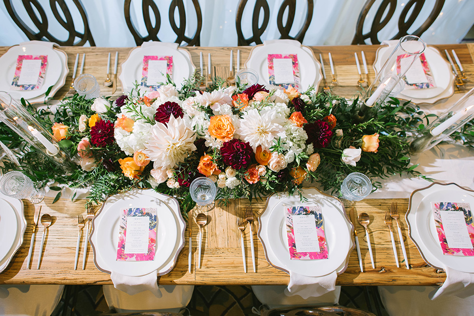 rustic chic table with pink and burgundy flatware details