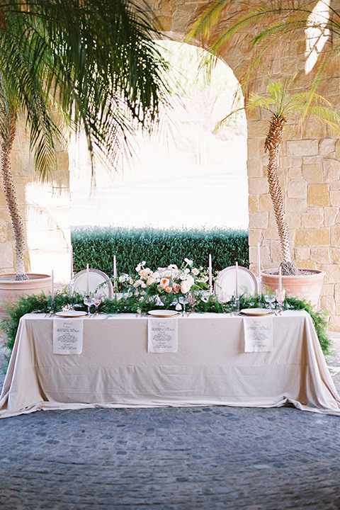 cream table linens and green florals