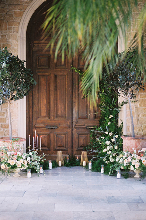 ceremony space in front of old wooden doors