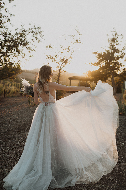 bride in a tulle a line gown with a sweetheart neckline and a crystal bodice