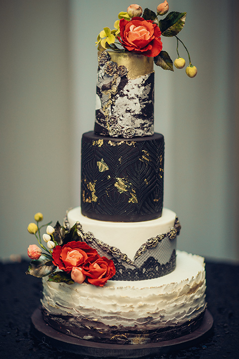 black and silver cake with red flowers