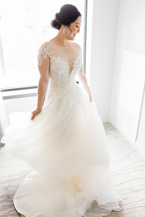 bride in a tulle ballgown with a plunging neckline and a loose bun