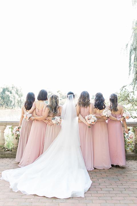 bride and bridesmaids cheerning