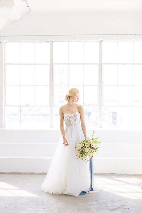 bride in a flowing modern tulle gown