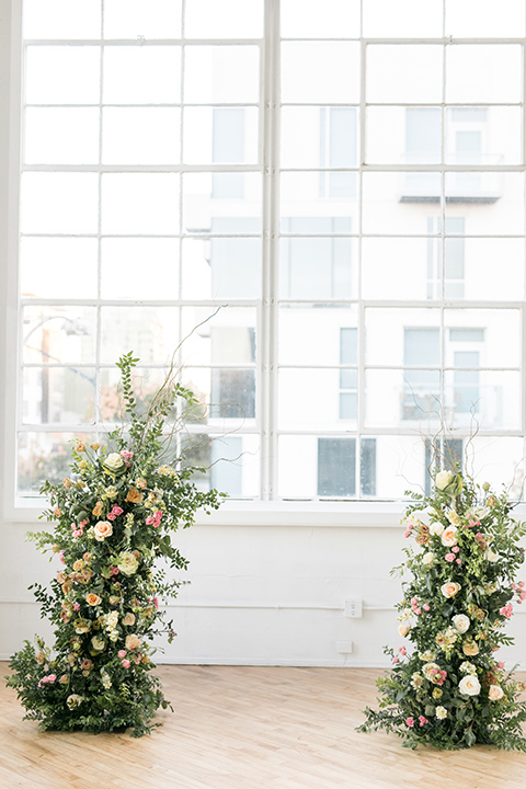 ceremony floral arch in front of windows