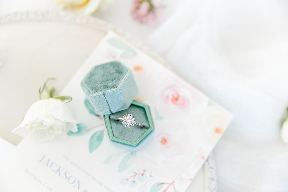 the wedding ring with a teal velvet box