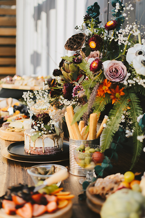 bohemian wooden table with appetizers and deserts on it
