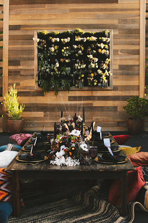 reception space with bohemian style table and decor