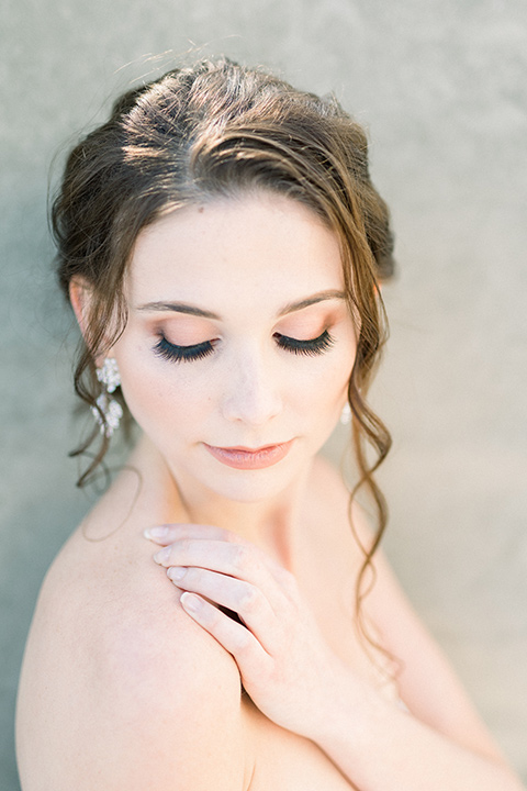bridal hair with a loose bun and curls