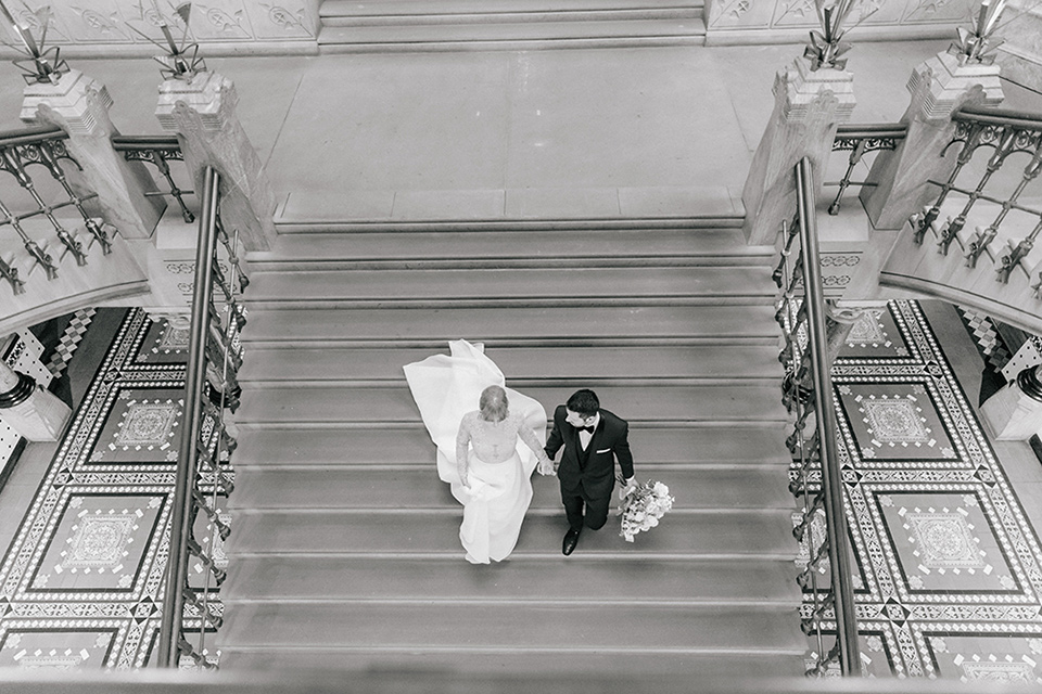 bride and groom walking down the stairs from above