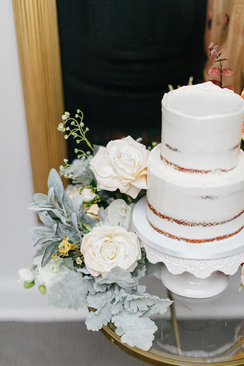 white cake with white flowers as decor