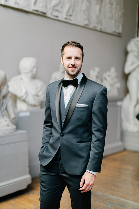 the groom in a navy shawl lapel tuxedo with a black satin lapel