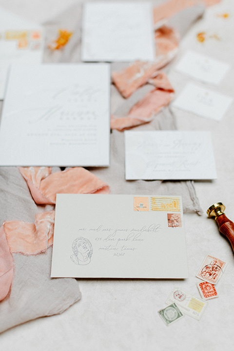 white invitations with light blush pink floral design
