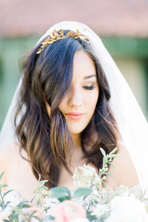 bride with a long cathedral veil and delicate makeup
