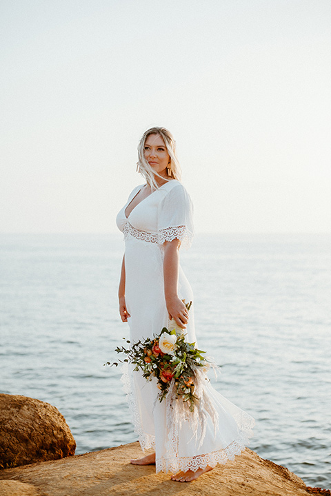 bride in a casual lace white gown in a bohemian style