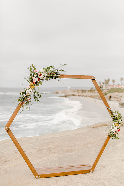 geometric ceremony arch with pink and green florals