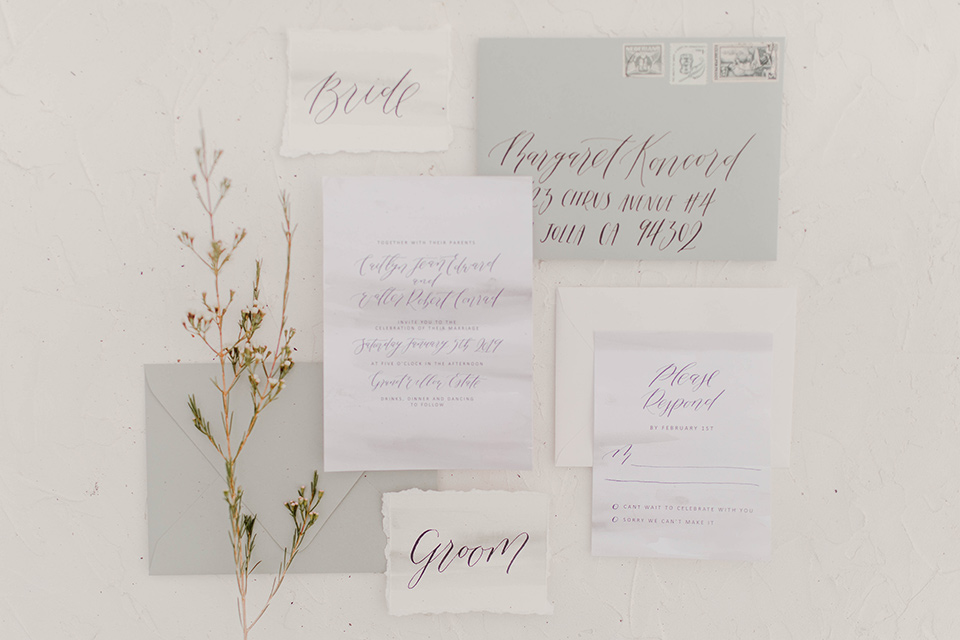 white invitations with grey details