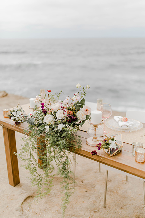 wooden tables with bountiful florals and white plates