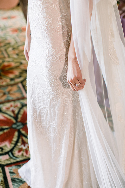 bridal gown with a lace and crystal design on it with long sleeves