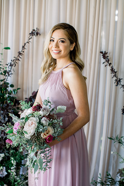 bridesmaid in a rose pink long gown with straps