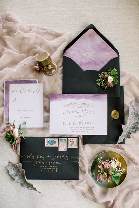 black envelopes and white invitations with gold and lavender touches