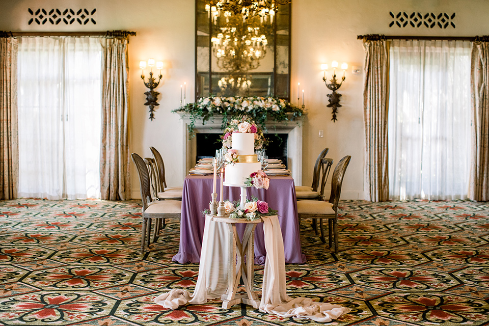 table with flowing purple linens and gold decor