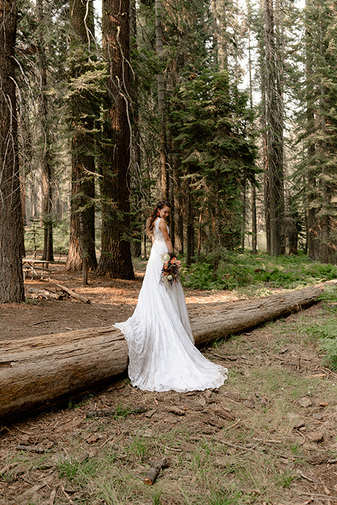 bride in a lace white gown with lace straps and a formfitting bodice