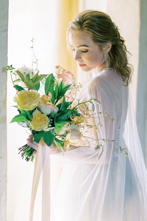 bride looking over her shoulder in a white flowing gown